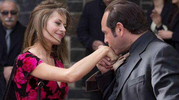 Charming rogue: Madeleine West as Danielle McGuire and Robert Mammone as Tony Mokbel in <i>Fat Tony & Co</i>.