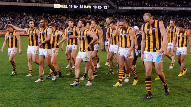 The Hawks leave the field after yet another loss to Geelong.