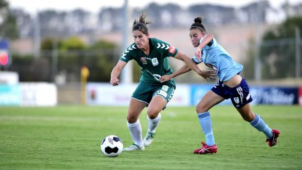 Canberra United's Caitlin Munoz and Sydney FC's  Chloe Logarzo clash in January.