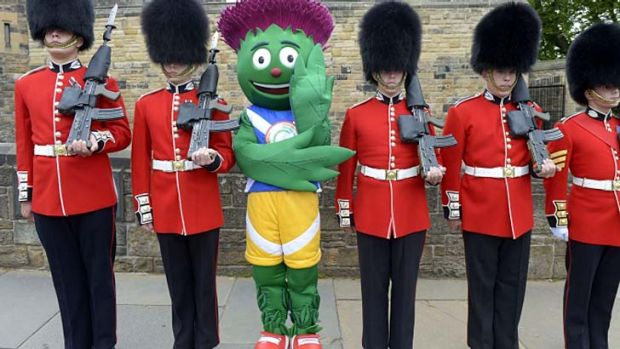 Making an appearance: Glasgow 2014 mascot Clyde lines up with the Scots Guards.