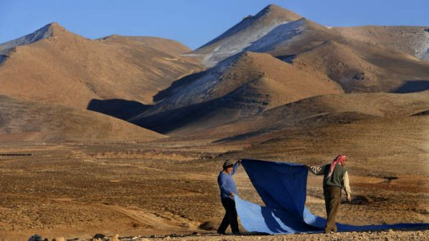 On the run: Two Syrian men who fled from Yabroud set up their tent near eastern Lebanon.