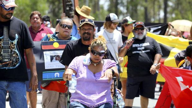 Sheila Oakley leads the march from her home to the Logan District station.