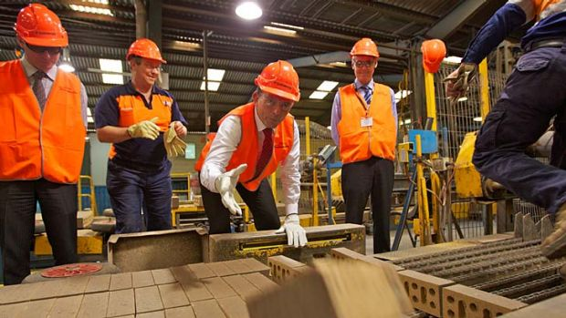 High visibility: As opposition leader in 2011, Tony Abbott warned this Sydney brick manufacturer it would lose $2 ...