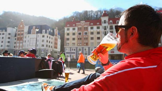 One spectator in Sochi found a way to enjoy a cleansing ale.