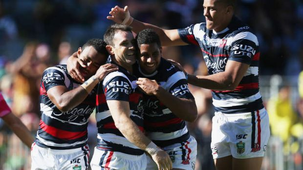 Brad Fittler is mobbed by teammates after scoring an intercept try.