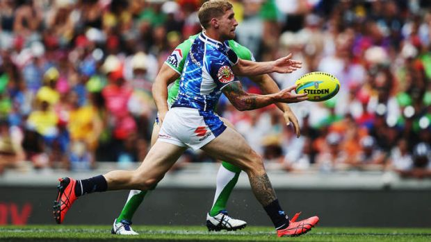 Impact: Star recruit Sam Tomkins passes the ball in the Warriors' win against the Raiders in the Auckland Nines on Saturday.