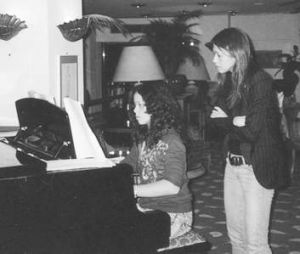 Amy Chua supervising her daughter Sophia at the piano.