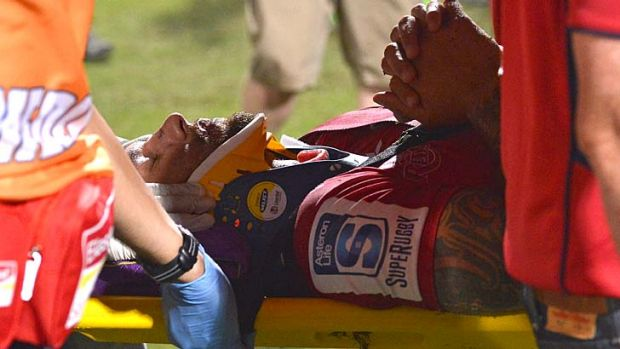 Quade Cooper is carried out on a stretcher in a neck brace during the Super Rugby trial match between the Queensland ...