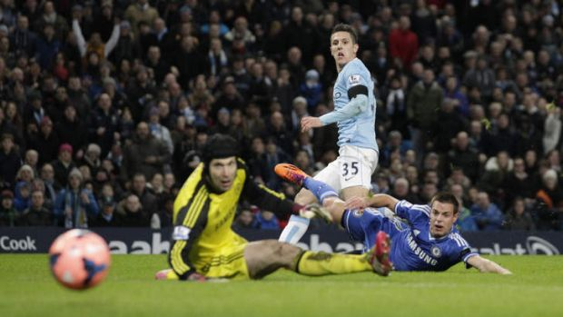 Goal-bound: Manchester City's Steven Jovetic puts the ball past Chelsea keeper Petr Cech during their FA Cup fifth-round ...
