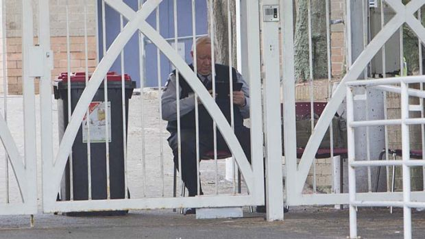 A security guard at the gates of Jewish school Moriah College at Queens Park, Sydney.