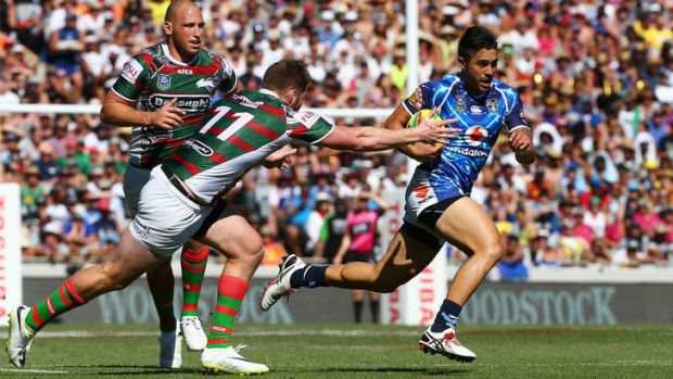 Warriors halfback Shaun Johnson makes a break against the Rabbitohs in the Auckland Nines at Eden Park.