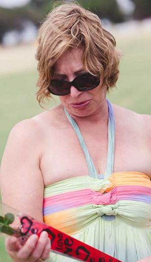 Rosie Batty reads messages left by well-wishers after the death of her son Luke at a Tyabb oval.