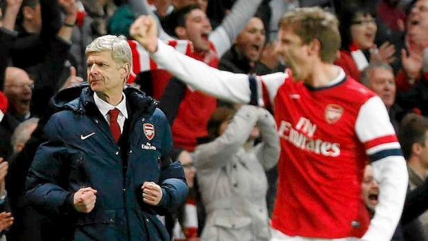 Last laugh: Arsenal's manager Arsene Wenger, left, celebrates their win against Liverpool.