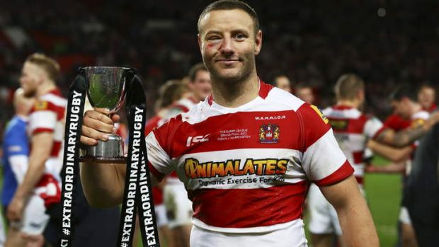 Wigan's Blake Green poses with the Harry Sunderland trophy following his team's 30-16 victory during the Super League ...