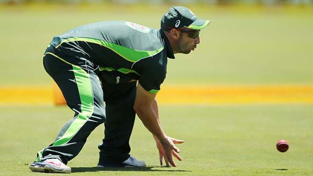 Phillip Hughes takes part in a fielding drill before the first Test.