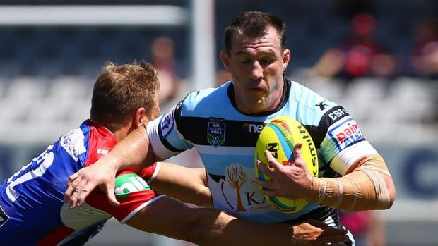 Cronulla captain Paul Gallen makes a break during the match against the Newcastle Knights in the Auckland Nines at Eden ...