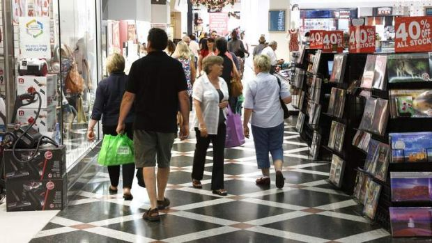 Shoppers outside Godfreys at Westfield Woden Plaza.