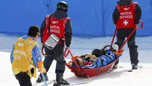 Jacqueline Hernandez of the US is carried off the track on a stretcher after crashing during the women's snowboard cross ...