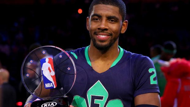 The Eastern Conference's Kyrie Irving of the Cleveland Cavaliers celebrates with the NBA All-Star Game MVP trophy at the ...