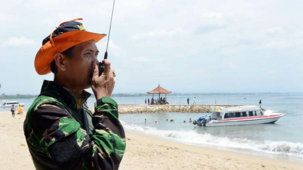 The rescue effort continues: An Indonesian rescue official monitors a team searching for seven Japanese divers missing ...