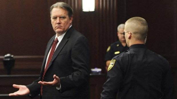 Guilty ... Michael Dunn raises his hands in disbelief as he looks toward his parents after the verdicts were announced ...
