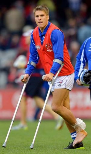 Andrew Swallow leaves the field in July last year after rupturing his Achilles against Melbourne in round 18.
