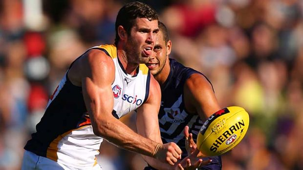 Jack Darling of the Eagles handballs under pressure.