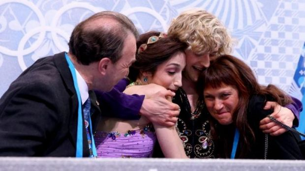 Tight bunch ... Meryl Davis  and Charlie White of the United States celebrate the gold medal with thier coaches Oleg ...