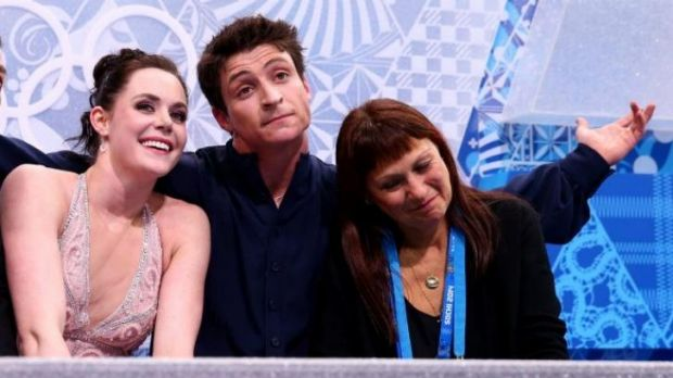Blame game ... Canada's Tessa Virtue and Scott Moir wait for their score with their coach Marina Zoueva in the figure ...