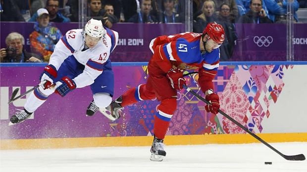Norway's Henrik Odegaard defends as Russia forward Alexander Radulov takes an off-balance shot.