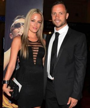 Oscar Pistorius and Reeva Steenkamp pose for a picture in Johannesburg just a week before she died.