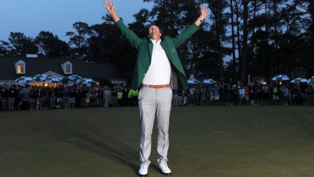 Adam Scott celebrates after being presented with the Masters green jacket.