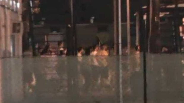 A screen grab, taken from the ABC, of riots on Manus Island on Sunday.