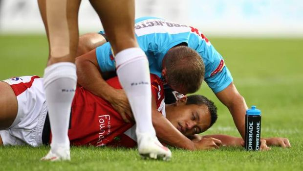 Sickening: Chase Stanley after getting knocked out during the Dragons' Charity Shield match against Souths in 2012.