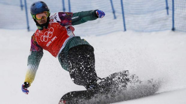 Chasing the dream: Alex Pullin competes in the men's snowboard cross quarter-finals at Rosa Khutor.