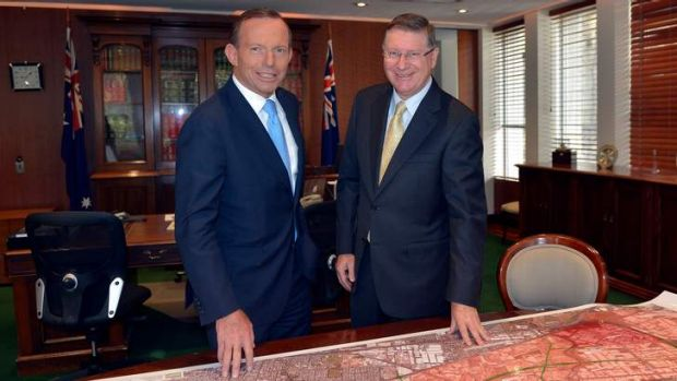 Australian Prime Minister Tony Abbott meets with Victorian Premier Denis Napthine to discuss Victoria's industrial job ...
