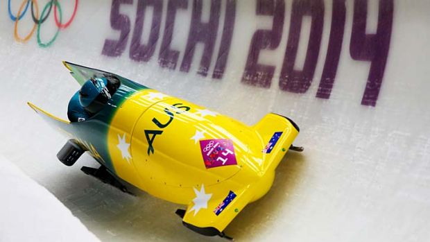 Astrid Radjenovic and Jana Pittman of Australia team 1 make a run during the women's bobsleigh heats on Tuesday.