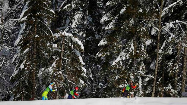 Competitors ski during the women's cross-country team sprint classic semi-final in Sochi on Wednesday.