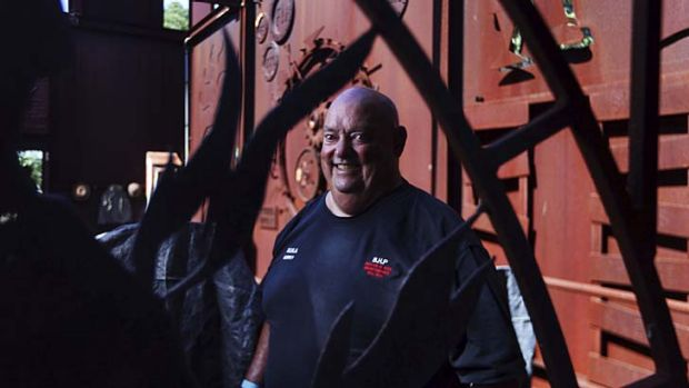 Memories: Aubrey Brooks, who spent 38 years working at Newcastle's BHP plant, at a commemorative sculpture near the ...