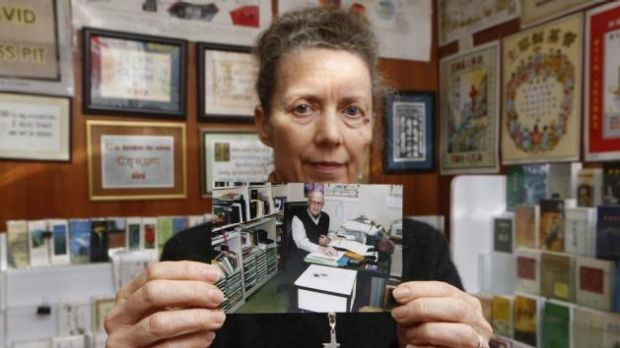 """There's no point [being] hysterical""' ... Karen Short, wife of Australian missionary John Short, poses with a photo of ..."