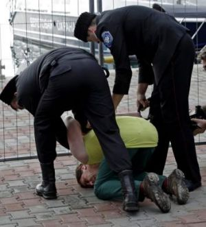 Cossacks restrain a male member of Pussy Riot after the group tried to perform in Sochi.
