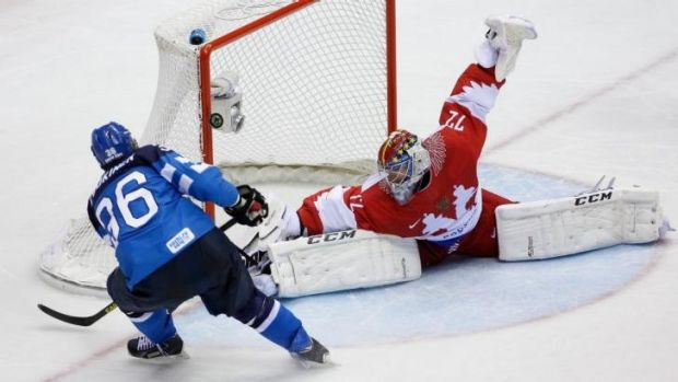 No respect for the hosts ... Finland forward Jussi Jokinen shoots on Russian goaltender Sergei Bobrovski during the ...