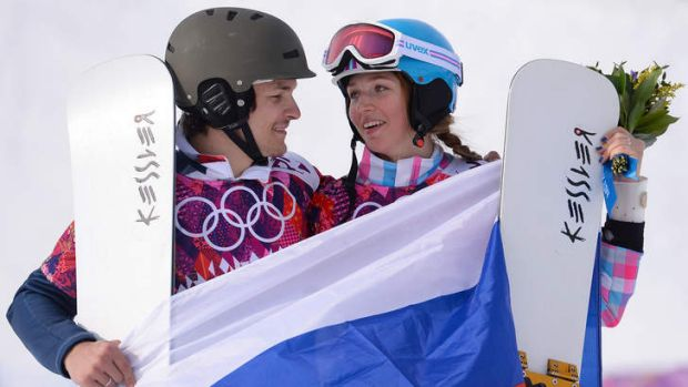 Happy couple: Vic Wild and Alena Zavarzina celebrate their medals.