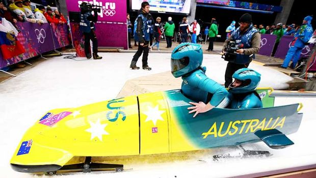 Astrid Radjenovic and Jana Pittman finish a run during the bobsleigh.