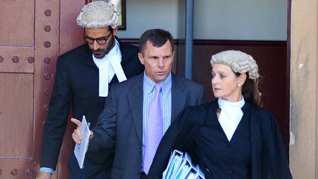 Accused murderer Paul Mulvihill with his legal team at the NSW Supreme Court.