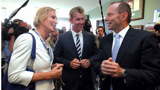 Lieutenant Colonel Cate McGregor, pictured with former cricketer Brett Lee and Prime Minister Tony Abbott, during the ...