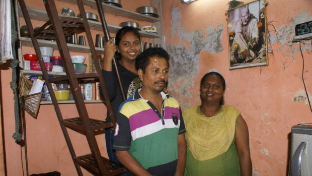 Jeeta Avekar in her flat with her husband and daughter.