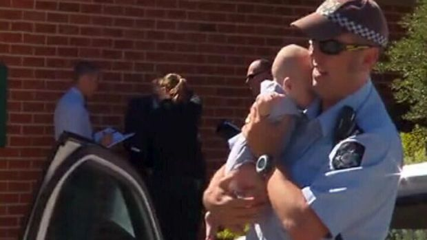 A police officer with the baby. <em> Photo: Courtesy Nine News </em>