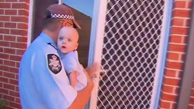 Police return the baby to its mother. <em> Photo: Courtesy Nine News </em>