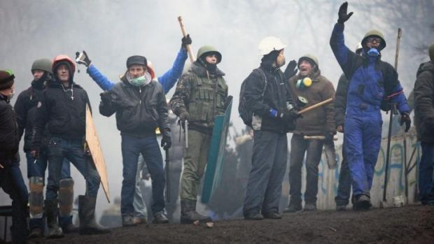 Protesters defy security forces in Kiev on Thursday.